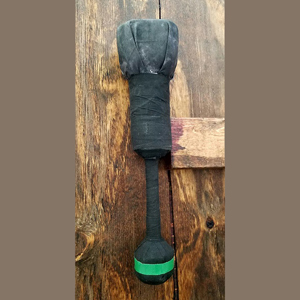 black foam dagger with black handle on wood background